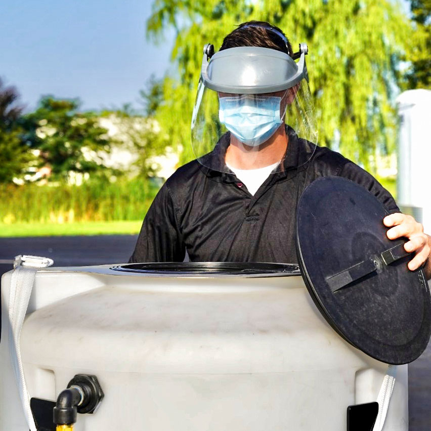 man opening lads-large are decontamination system tank